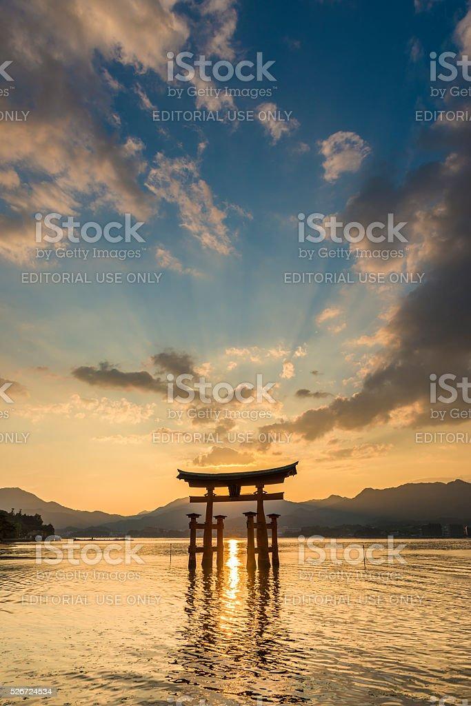 Sunset at the floating torii gate of the Itsukushima Shrine stock photo