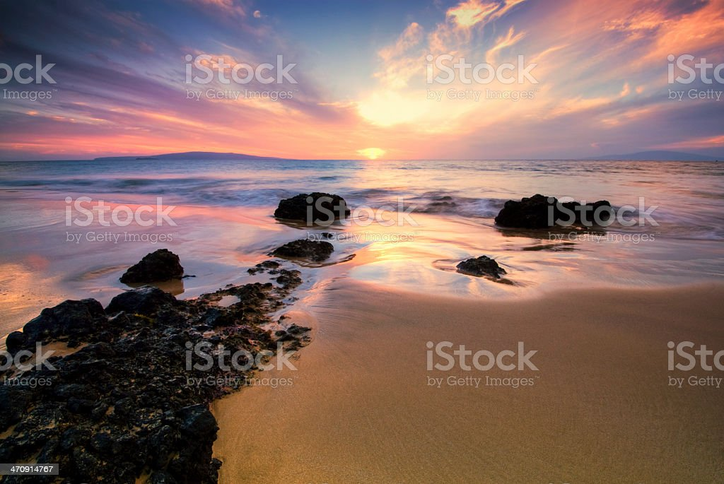 Sunset at the island of Maui in Hawaii stock photo