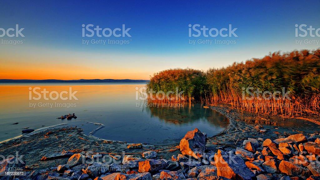 Sunset at the lake Balaton stock photo