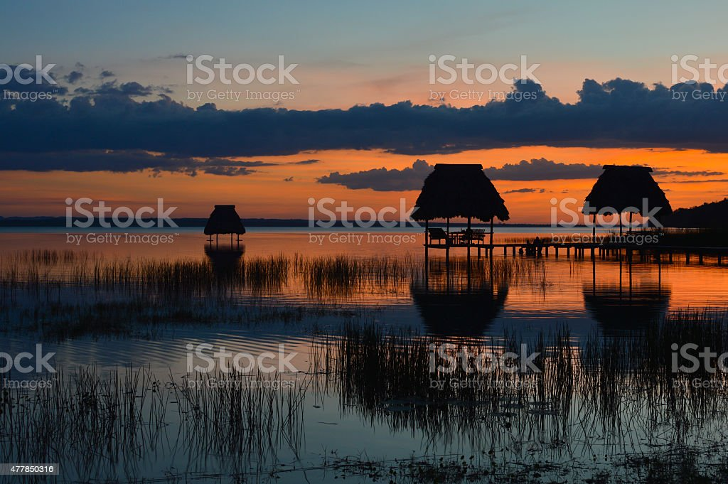 Sunset at the lake Peten Itza in El Ramate stock photo