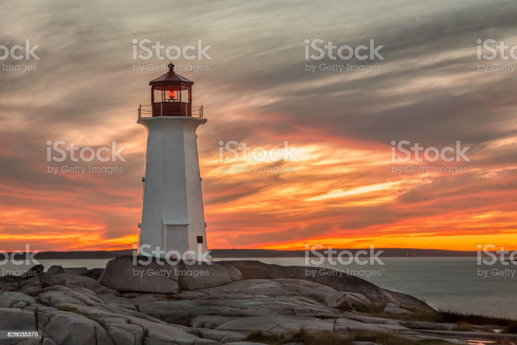 Sunset at the Lighthouse at Peggy's Cove near Halifax, Nova Scotia stock photo