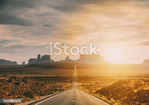 Sunset on the scenic road of the Monument Valley, desert of Utah (USA)