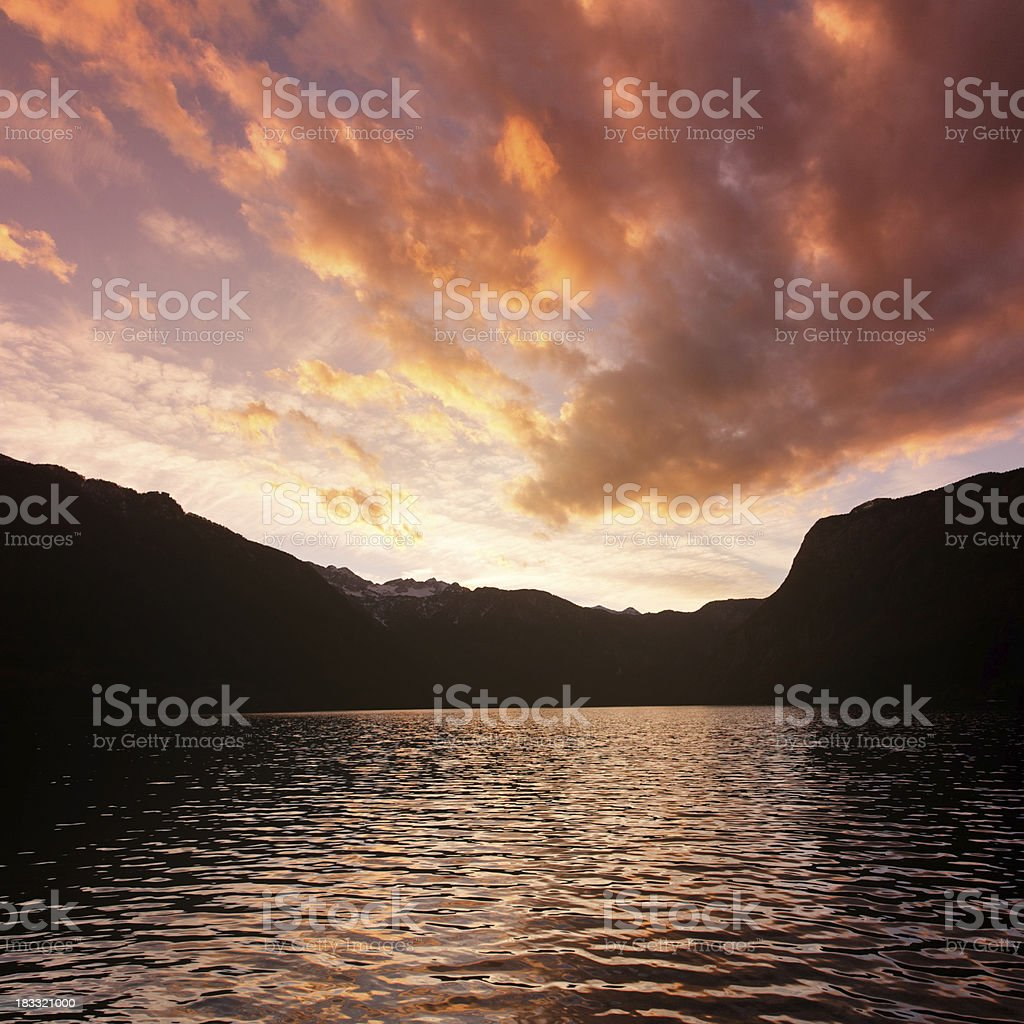 sunset at the mountain lake royalty-free stock photo