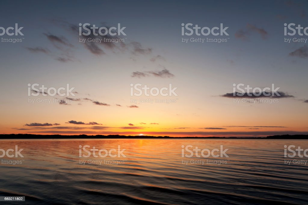 sunset at the ocean stock photo