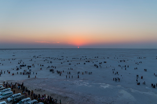 The Great Rann of Kutch is a salt marsh in the Thar Desert in the Kutch District of Gujarat, India. It is about 7500 km² in the area and is reputed to be one of the largest salt deserts in the world. This area has been inhabited by the Kutchi people.