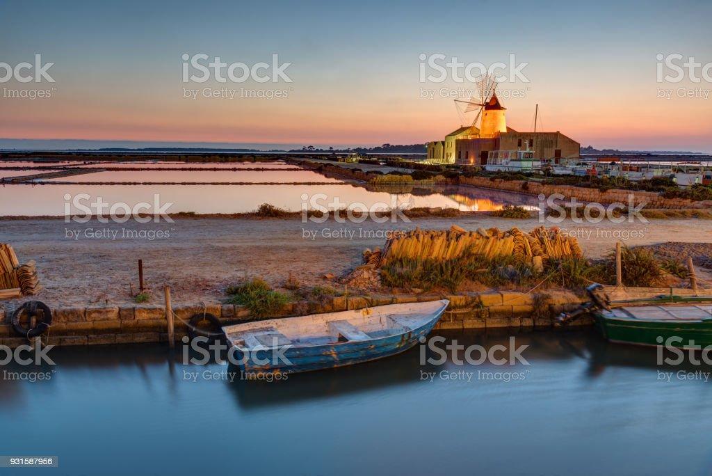 Sunset at the saltpans of Marsala stock photo