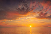 istock Sunset at the sea - shot in Wexford county, Ireland 874289460