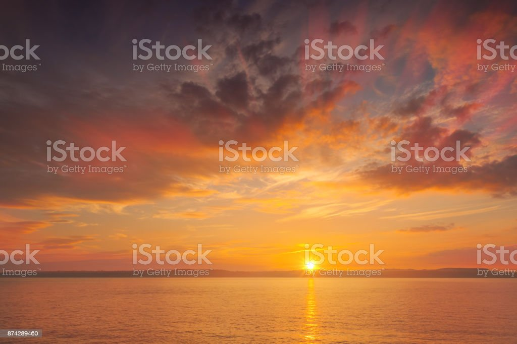 Sunset at the sea - shot in Wexford county, Ireland stock photo