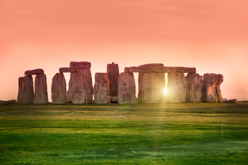 The prehistoric monument of Stonehenge in England.  Focus is on the grass.