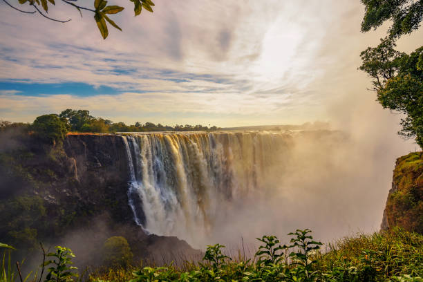 Sunset at the Victoria Falls on Zambezi River in Zimbabwe stock photo