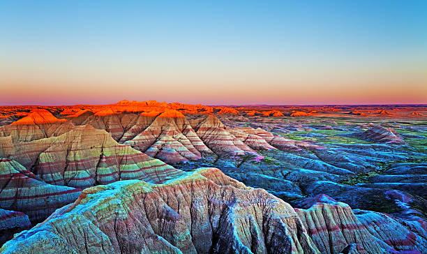 sunset at the wall, badlands national park, south dakota. - natural landmark stock pictures, royalty-free photos & images