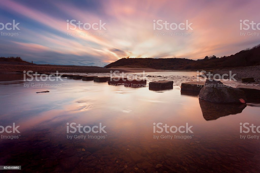 Sunset at Three Cliffs Bay stock photo
