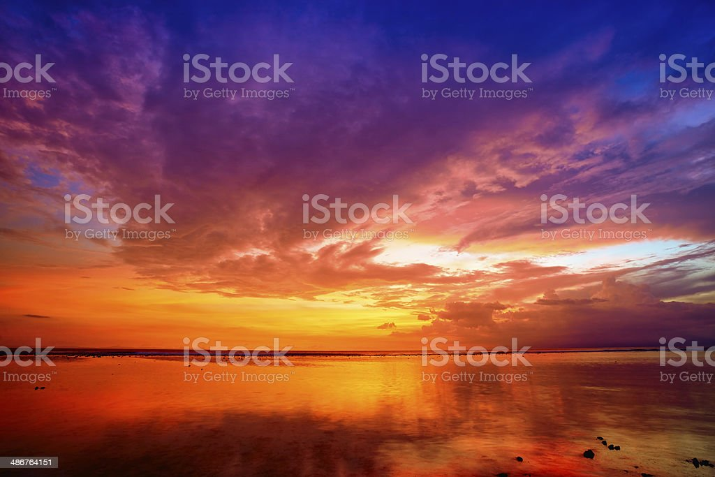 Sunset at tropical beach stock photo