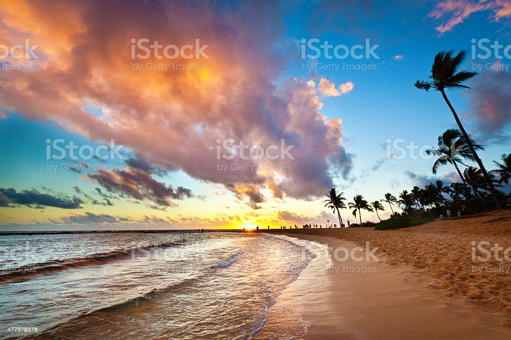 Sunset at Tropical Poipu Beach of Kauai, Hawaii stock photo