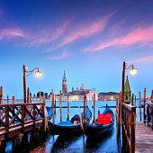 Gondolas at twilight in Venice, Italy. Composite photo