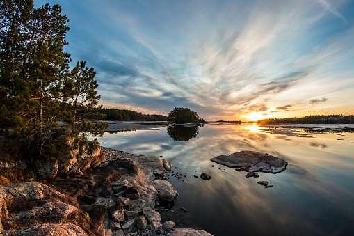 The sunset along the waters of Voyageurs National Park as seen from the Ash Visitor Center.