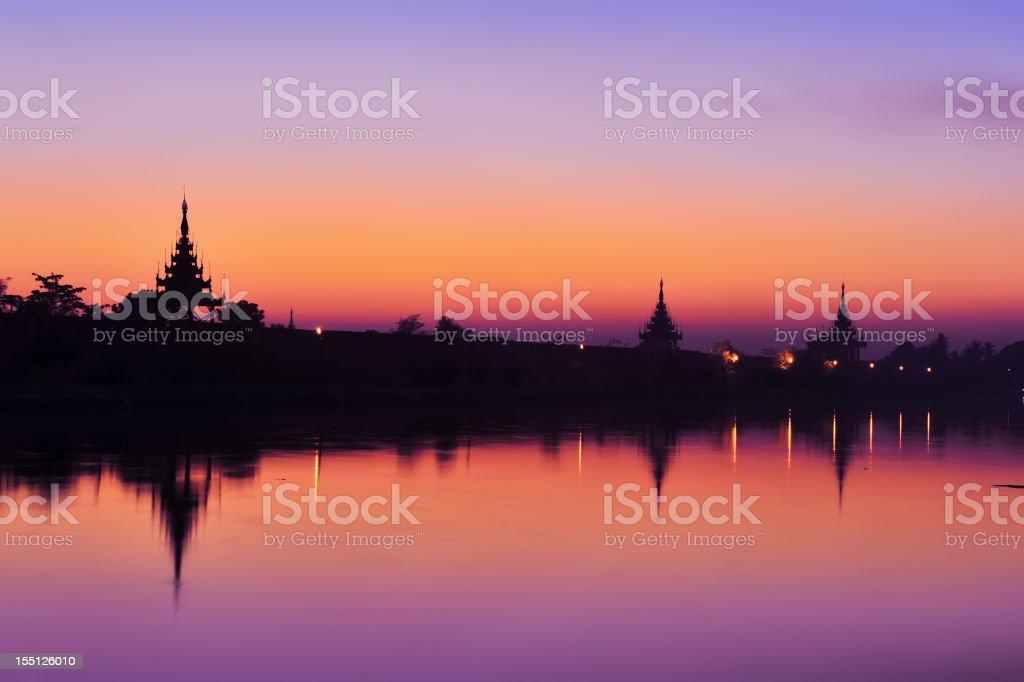 Sunset at wall of Mandalay palace stock photo