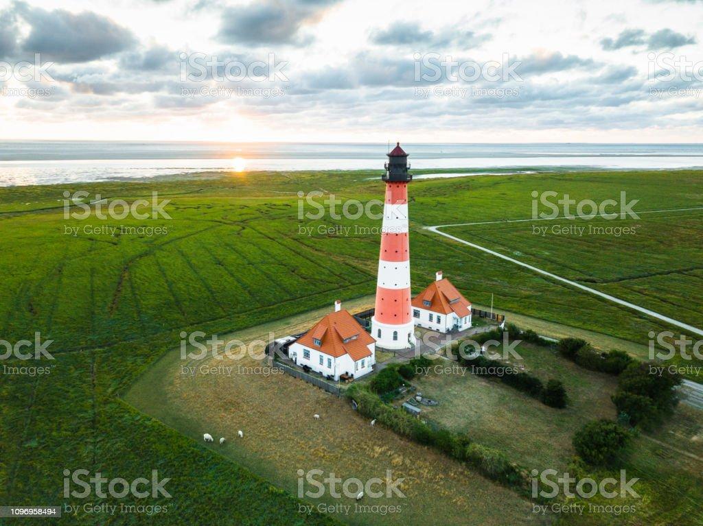 Sunset at Westerheversand Lighthouse Nordfriesland Germany stock photo