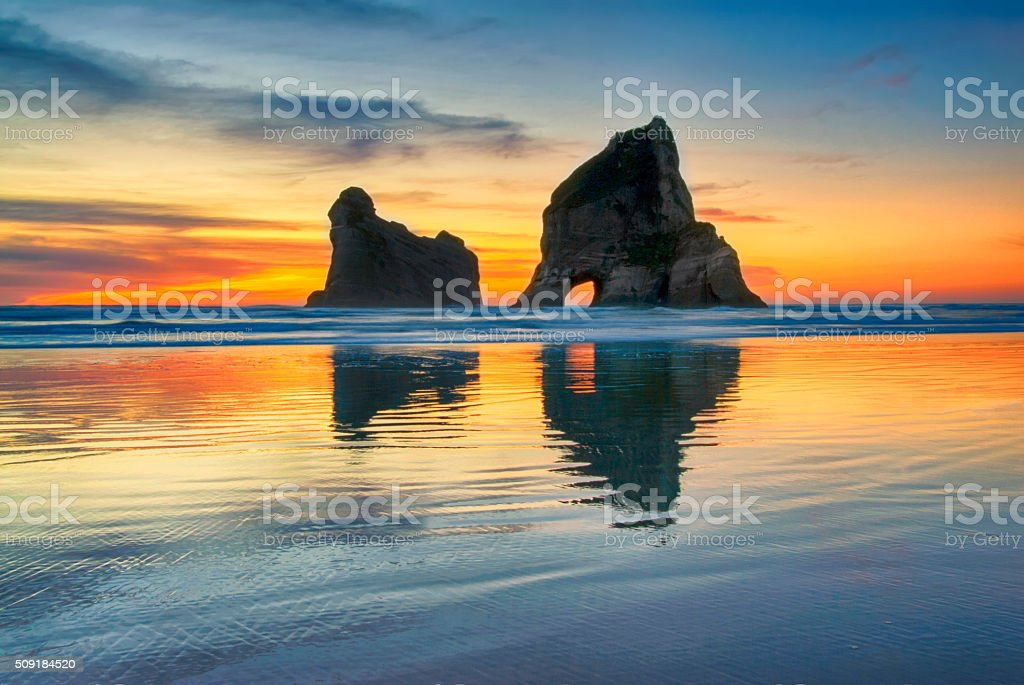 Sunset at Wharariki beach, New Zealand stock photo