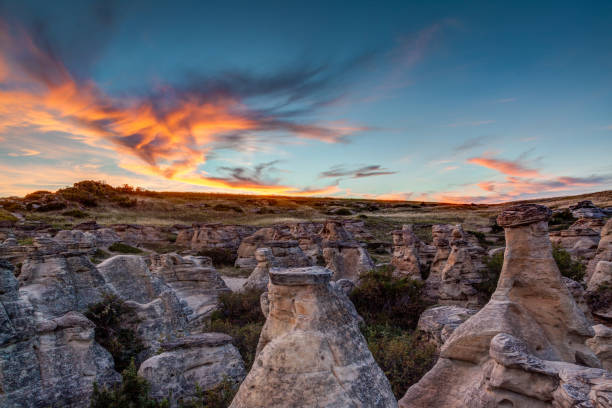 sunset at writing on stone provincial park in alberta, canada - provincial park stock photos and pictures
