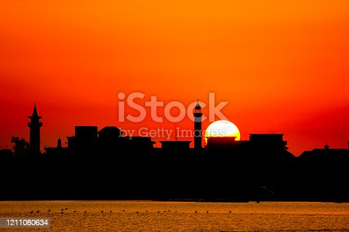 Sunset background in river with the mosque in th shadow.