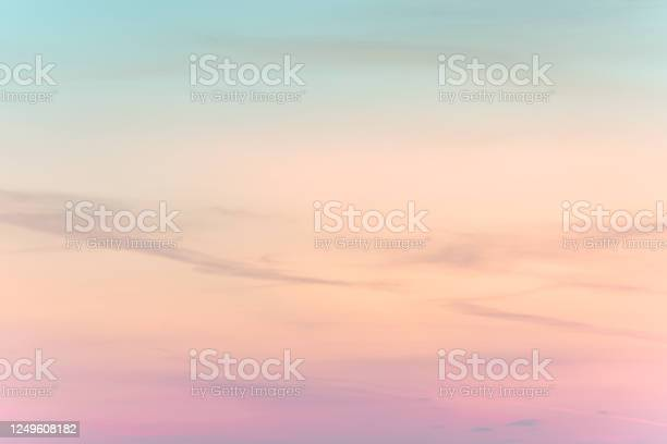 Photo of sunset background. sky with soft and blur pastel colored clouds.  gradient cloud on the beach resort. nature. sunrise.  peaceful morning.