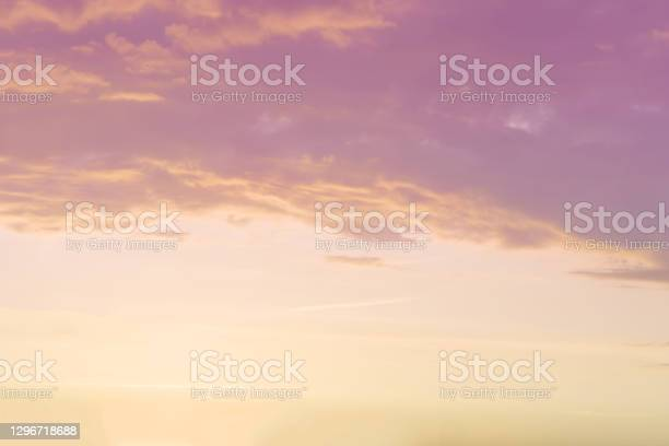Photo of sunset background. sky with soft and blur pastel colored clouds.  gradient cloud on the beach resort. nature. sunrise.  peaceful morning. Instagram toned style