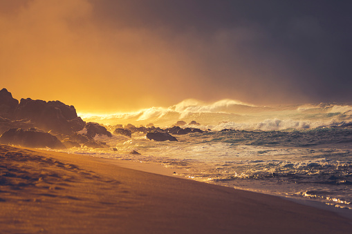 tropical storm during sunset at maui beach. hawaii islands.