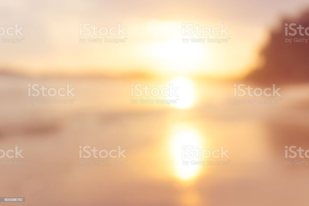 sunset beach blurry background stock photo
