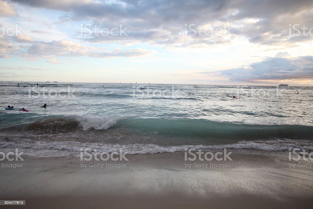Sunset beach in Waikiki, Hawaii stock photo