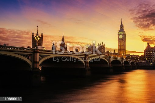 Dramatic sunset color over famous Big Ben clock tower in London, UK.