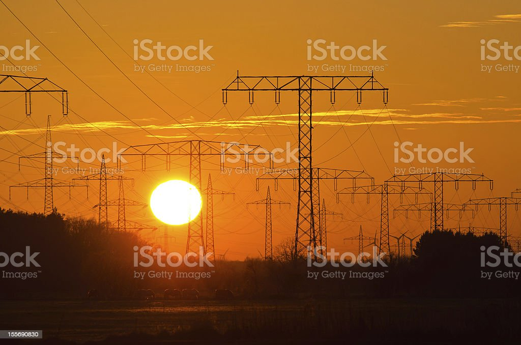 Sunset behind a power line stock photo