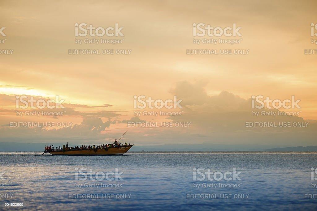Sunset behind a refugee boat on Lake Tanganyika stock photo