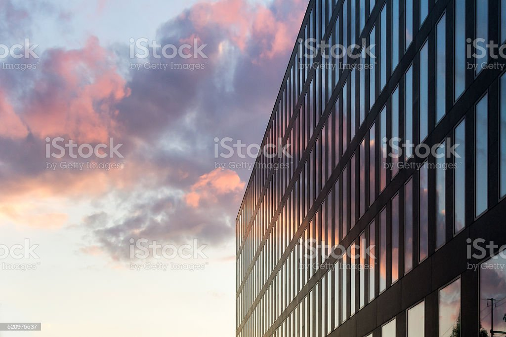 sunset behind business building stock photo