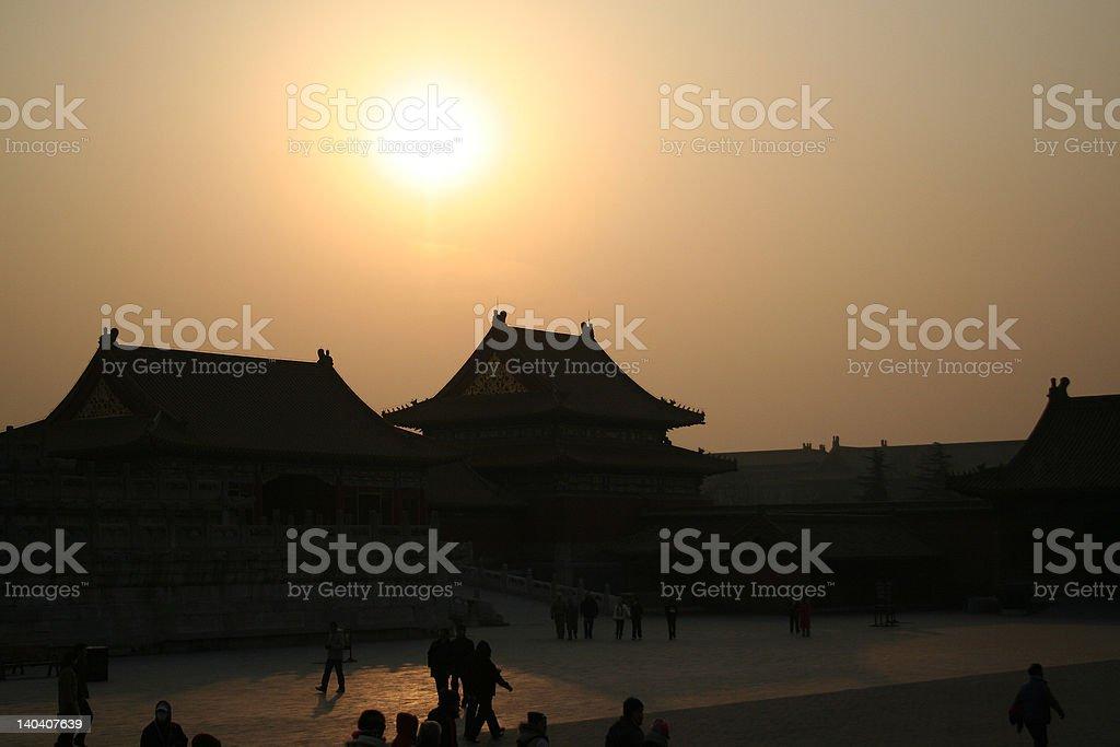 sunset behind Chinese palace royalty-free stock photo