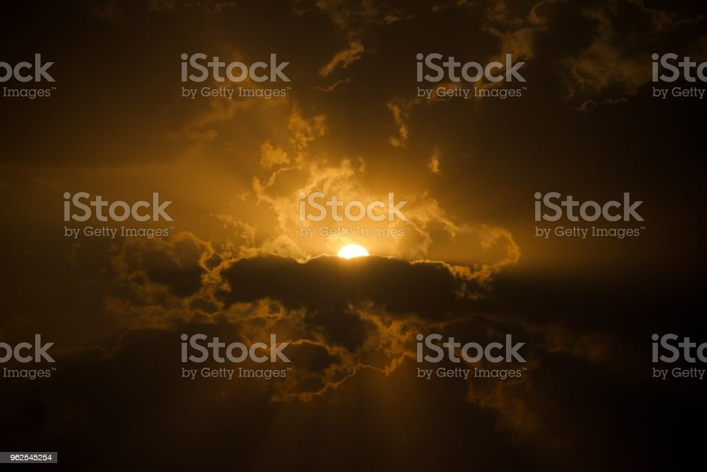 Sunset Behind Clouds with God Rays - Royalty-free Contrasts Stock Photo