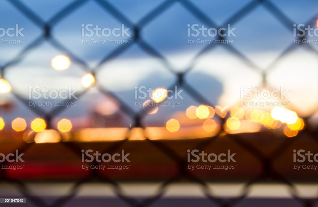 Sunset behind the barbed wire - fence with sunset background stock photo