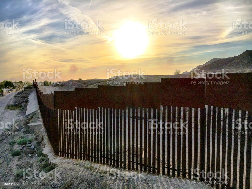 Sunset behind the border stock photo