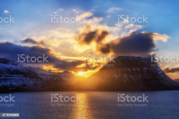 Photo of Sunset behind the famous mountain Kirkjufell in Iceland