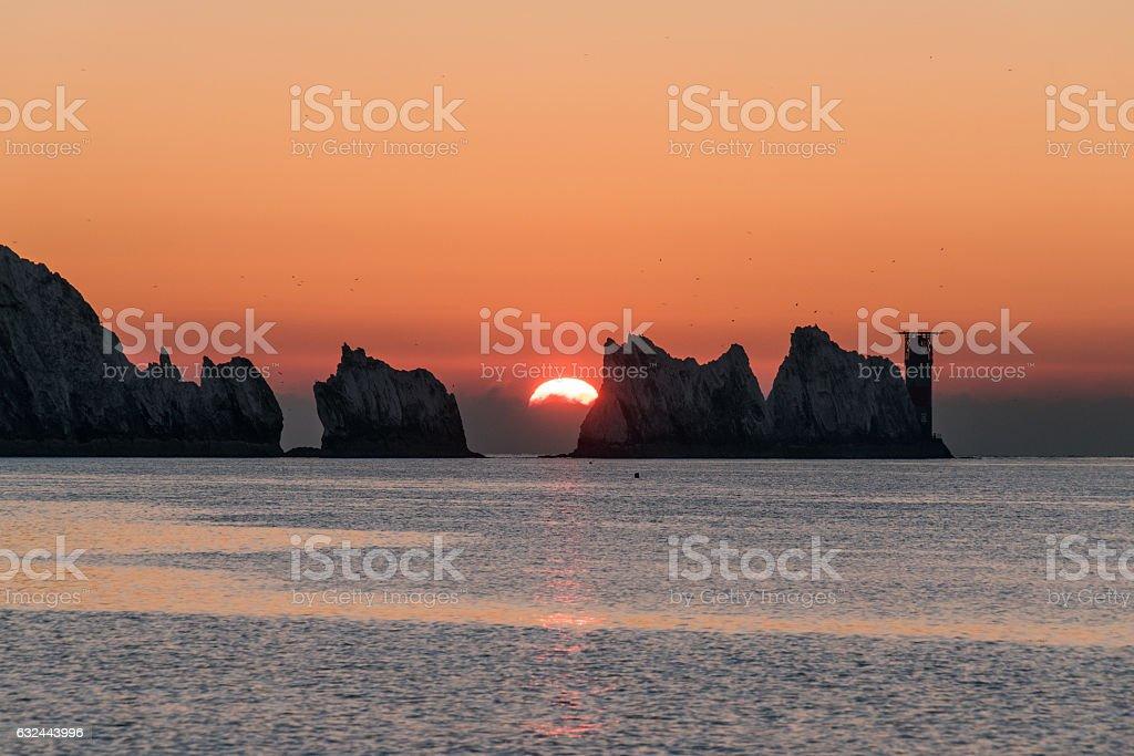 Sunset behind The Needles stock photo