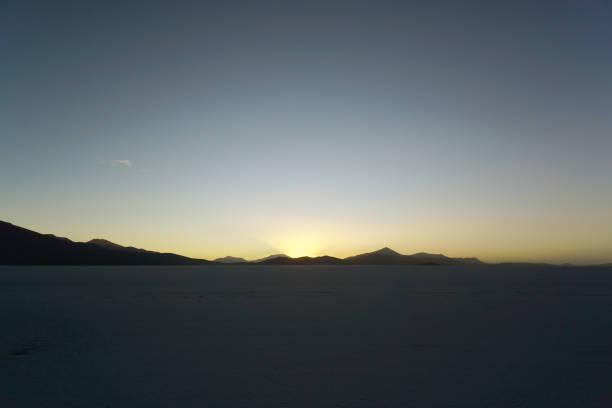 Sunset behind the Salar mountains of Uyuni, Bolivia stock photo