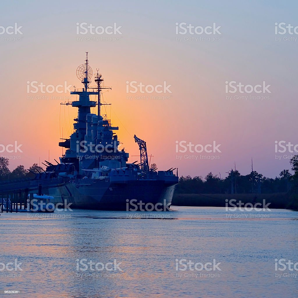 Sunset behind USS North Carolina stock photo