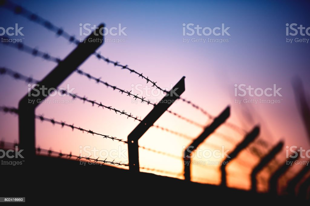 Sunset Behind Wall stock photo