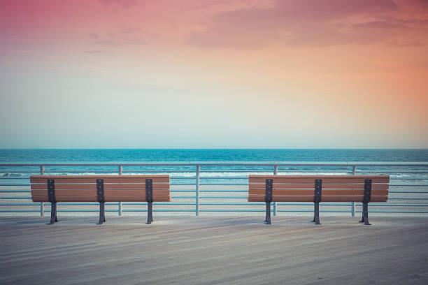 Sunset Benches beach stock photo