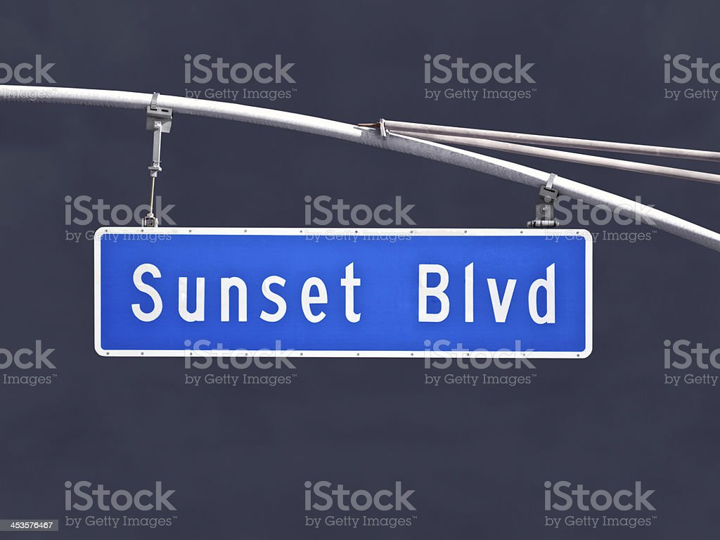 Sunset Blvd Overhead Street Sign with Dark Storm Sky royalty-free stock photo