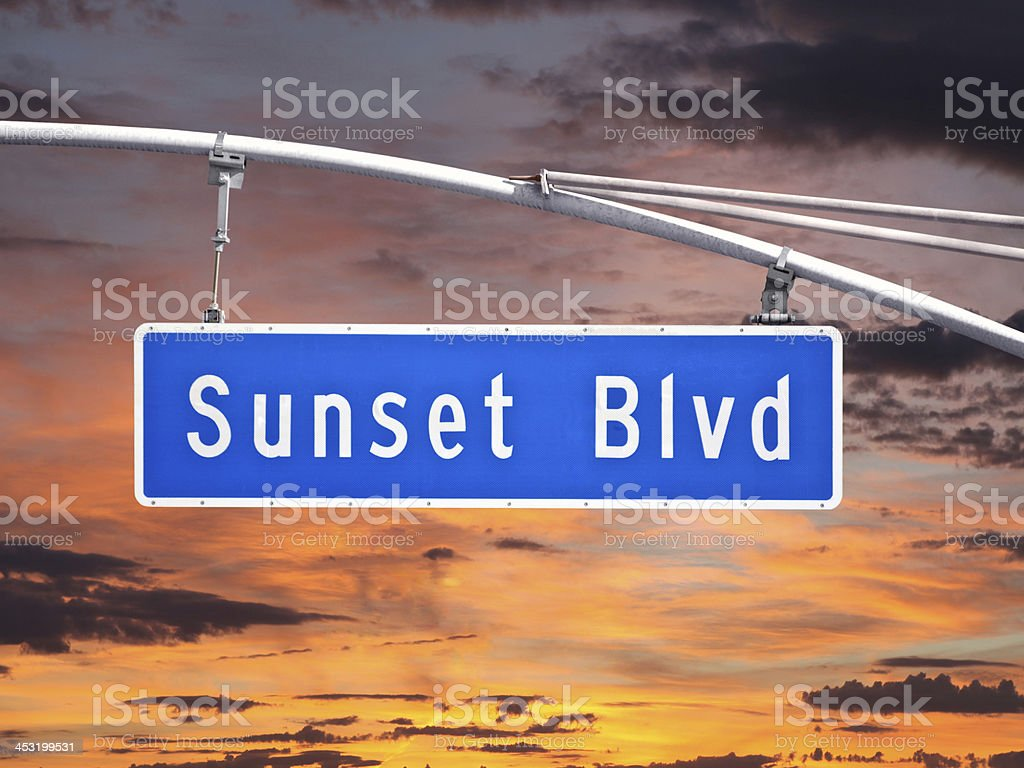 Sunset Blvd Overhead Street Sign with Dusk Sky royalty-free stock photo