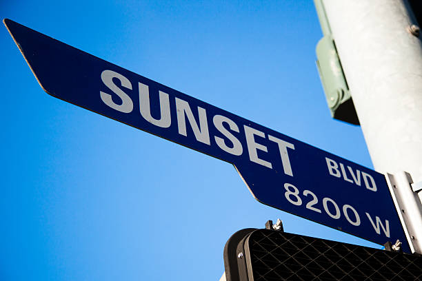 Sunset Blvd. sign with blue sky in Los Angeles Outdoor daylight photo of Sunset Blvd. sign with blue sky in Los Angeles sunset strip stock pictures, royalty-free photos & images