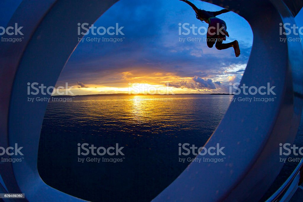 Sunset Boat Jump stock photo