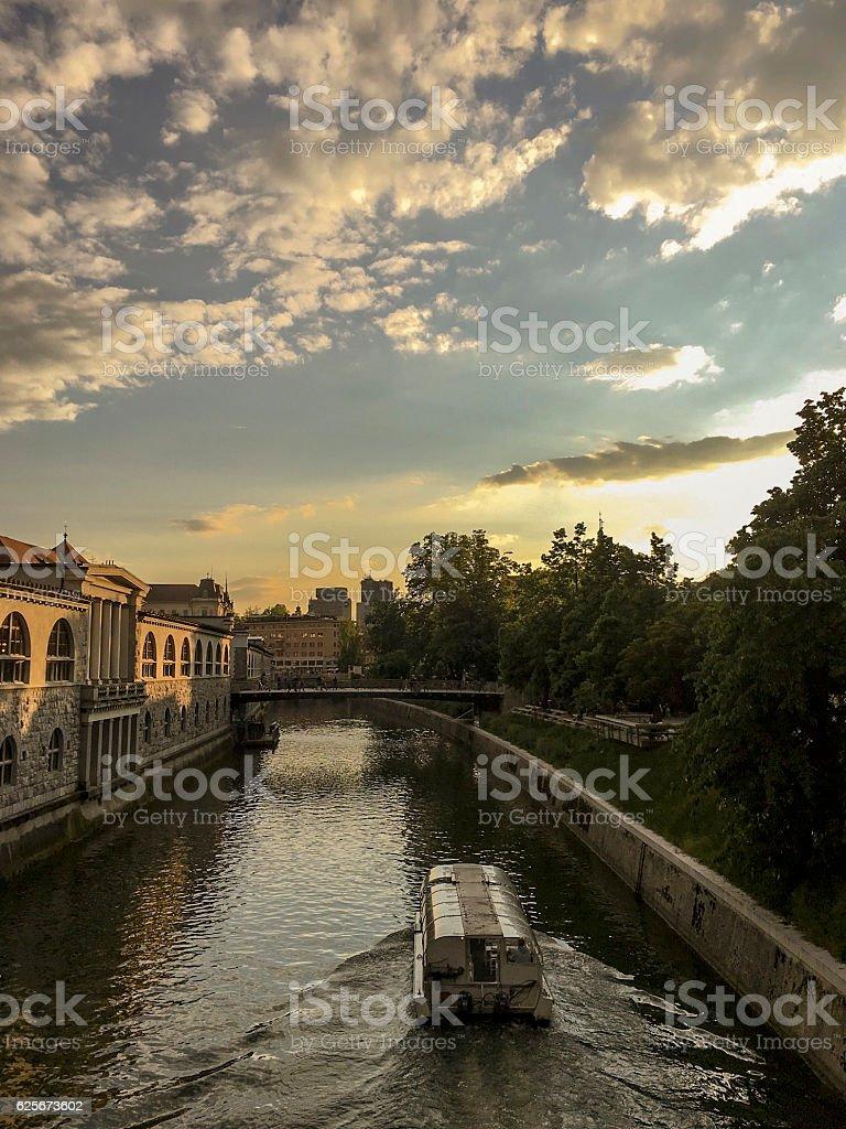 Sunset Boat on Ljubljanica River in Ljubljana Slovenia ストックフォト