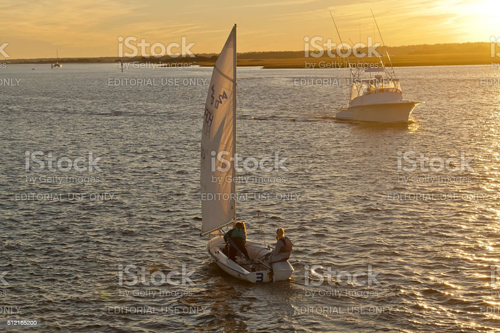 Sunset Boating on Rippled Waters stock photo